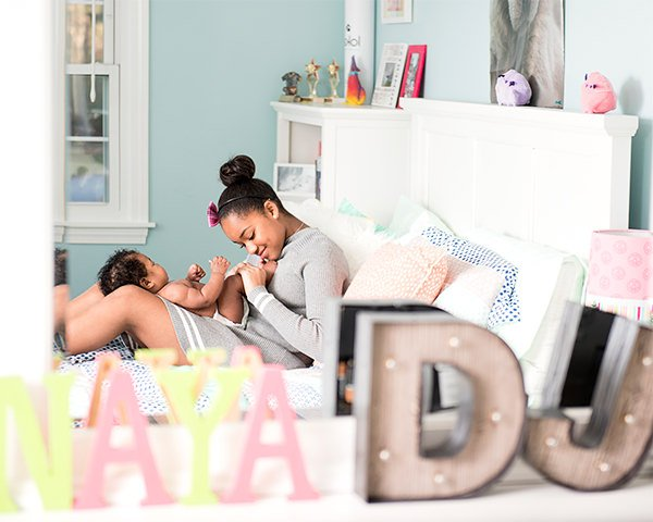 in home lifestyle newborn photo with big sister Q Hegarty Photography photographer in Wilmington, MA