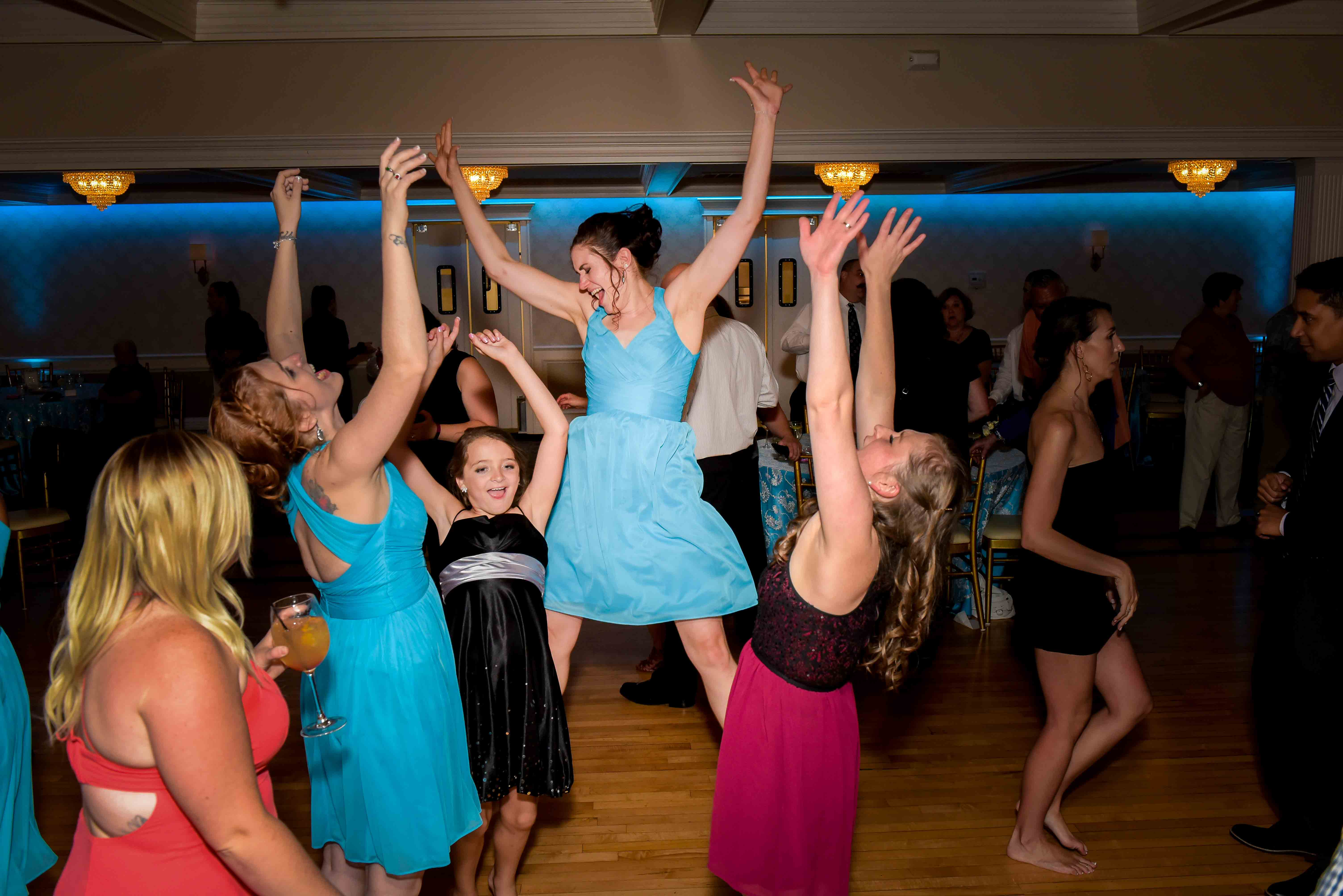 fun dance party at wedding reception by Q Hegarty Photography the best wedding photographer near Mount Sunapee Resort Newbury, Nh