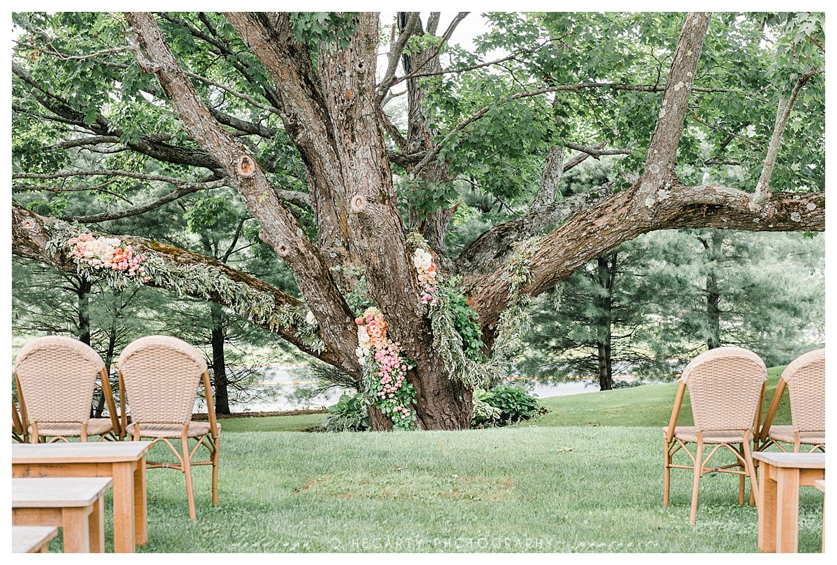 perfectly decorated wedding ceremony tree The red barn at outlook farm wedding Q Hegarty Photography