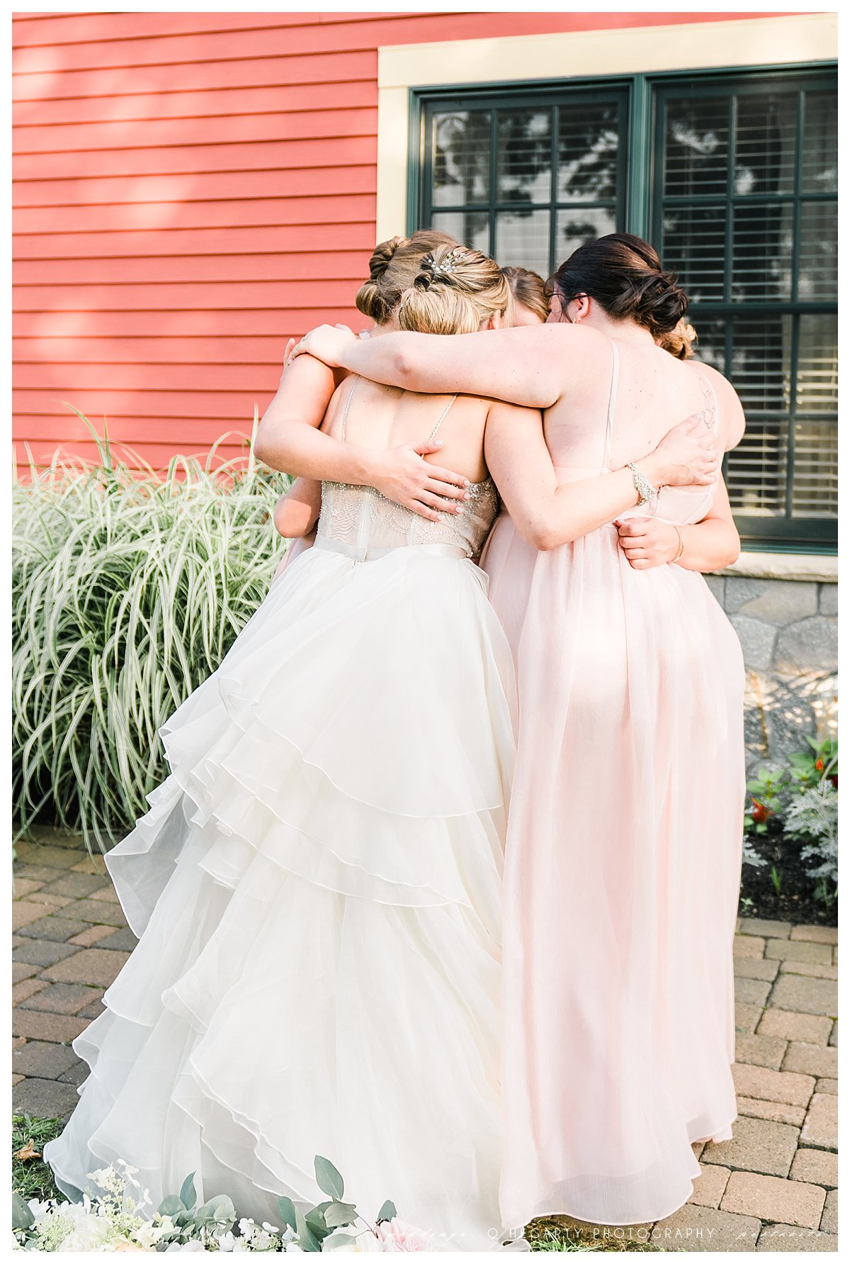 bridal party group hug photos by Q Hegarty Photography The red barn at outlook farm wedding