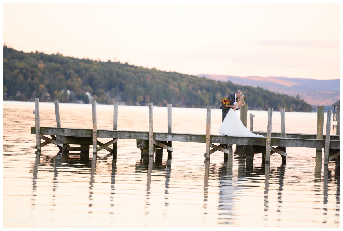 bride and groom portraits on lake Winnipesaukee chase house mill falls wedding by Q Hegarty Photography