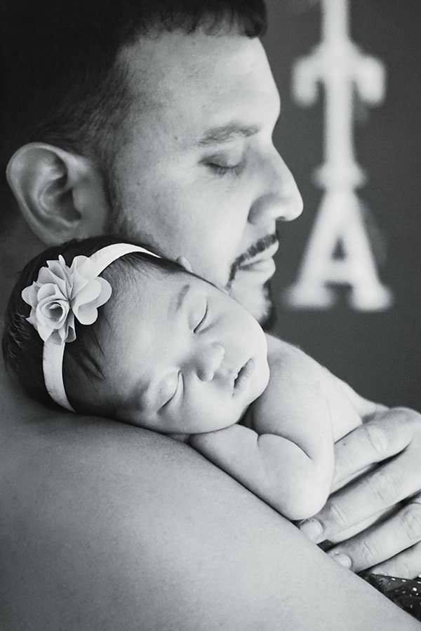 lifestyle newborn session baby in daddy's arms photographer Chelmsford MA Q Hegarty Photography